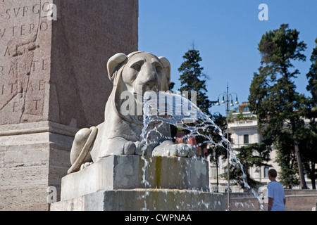 An Egyptian Lion water fountain in Piazza Del popolo in Rome Italy - Stock Photo