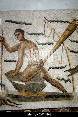 Roman mosaic of man spearing an octopus in the Bardo Museum Tunisia - Stock Photo
