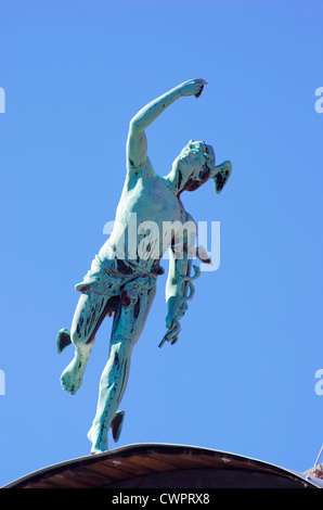 Greek God Hermes and Roman God Mercury on rooftop, Vrchlabi, Czechia. - Stock Photo