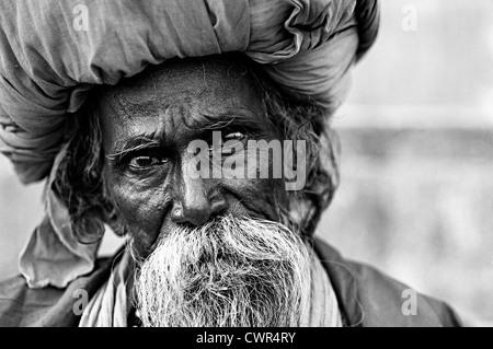 Elderly sadhu wearing a big turban. Varanasi, Uttar Pradesh, India - Stock Photo