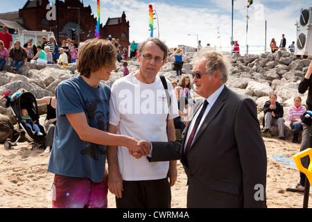 UK, England, Lancashire, Morecambe, Cedric Robinson presenting Sandcastle Festival prizes - Stock Photo