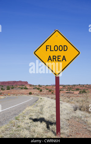 vertical image of flood area sign in the desert - Stock Photo