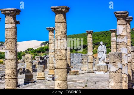 Trajan statue and Basilica at the Roman ruins of Baelo Claudia in Bolonia beach , Tarifa , Cadiz , Andalusia , Spain - Stock Photo
