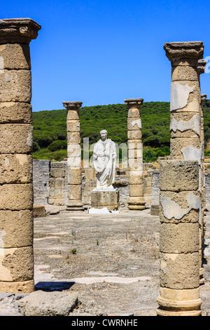 Trajan statue and Basilica at the Roman ruins of Baelo Claudia in Bolonia beach , Tarifa , Cadiz , Andalusia , Spain