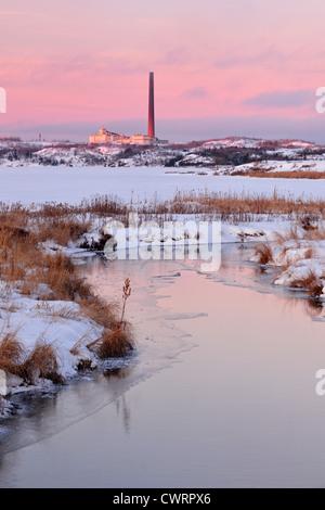 Vale chimney reflected in Robinson Creek, Greater Sudbury, Ontario, Canada - Stock Photo