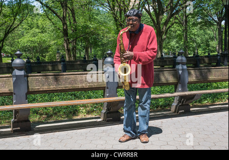 Tenor saxophone jazz player busking on the Central Park Mall in New York City - Stock Photo
