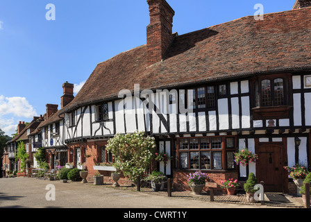 Row of timber-framed Tudor period houses in picturesque medieval Chilham village square, Chilham, Kent, England, - Stock Photo