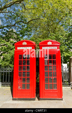Freshly painted London Red Phone Boxes - Stock Photo