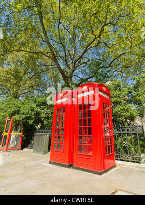 Contrasting London Phone Boxes - Stock Photo