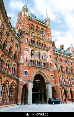 St Pancras Station in London with Black London Taxi - Stock Photo
