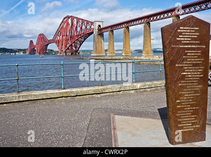 The iconic Forth Rail bridge viewed from the South Queensferry promenade with newly erected memorial right - Stock Photo