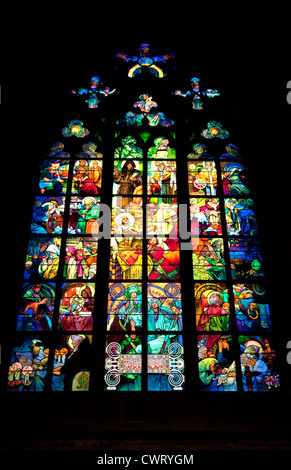 famed Mucha Stained Glass Window brings thousands of art lovers to the interior, St. Vitus Cathedral (Katedrala - Stock Photo