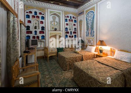 hotel bedroom in traditional style, Sasha and Son Hotel, Bukhara, Uzbekistan - Stock Photo