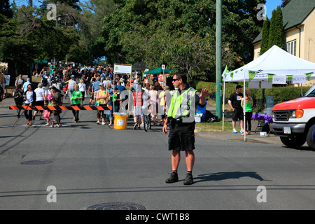 police man directing traffic - Stock Photo