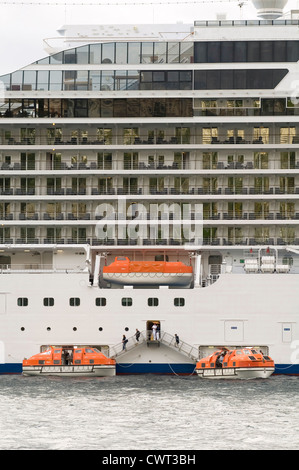 cruiseship cruise ships ship lifeboat lifeboats boats life being launched passengers being evacuated - Stock Photo