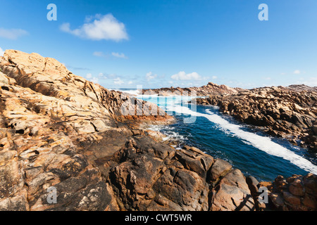 In yallingup, A series of rocks jut into the ocean creating a natural canal hollowed out by the force of the sea. - Stock Photo