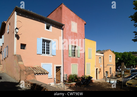 Colourful Houses or Multicoloured Village Houses at Roussillon in the Luberon Regional Park Vaucluse Provence France - Stock Photo