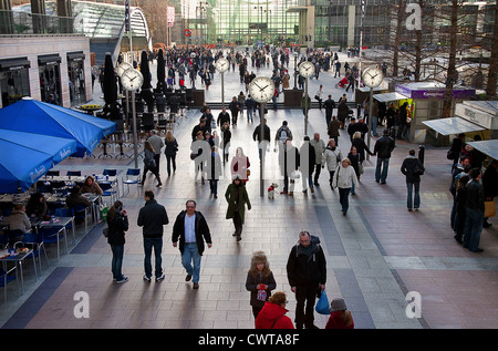 United Kingdom. England. London.Canary Wharf. Reuters Plaza in Canary Wharf. Crowds of people indoors. - Stock Photo