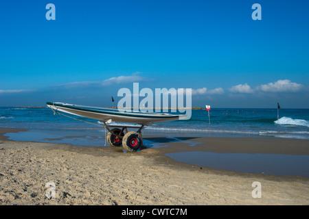 Hasake board in Tel Aviv beach , Hasake is a hollow vessel of wood used for lifesaving. - Stock Photo