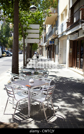 Empty street cafe in one of the Barcelona's street. - Stock Photo