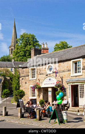People eating and drinking at Kings Court cafe and shops Bakewell Derbyshire Peak District England UK GB EU Europe - Stock Photo