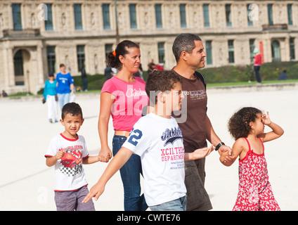 Paris, France - Family walking around the  Louvre Museum - Stock Photo