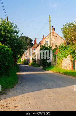 A view of traditional Norfolk cottages in the coastal village of Salthouse, Norfolk, England, United Kingdom. - Stock Photo