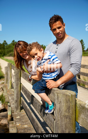 Couple and their little son enjoying time together on a sunny day - Stock Photo