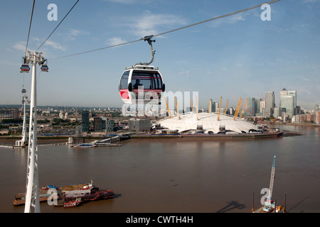 The Emirates Air Line Cable Car system crossing the River Thames from the Royal Victoria Dock to Greenwich - Stock Photo