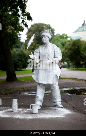 Street mime (baker character) acting on the streets of Tallinn, Estonia - Stock Photo