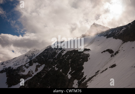 Summits of Taschhorn, Dom and Lenzspitze from the Mischabel Hut above Saas Fee in the Alps, Switzerland. - Stock Photo