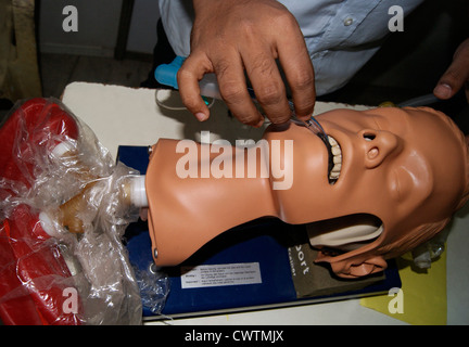 Doctor Explain how to give Artificial Respiration using Medical Devices to Dummy Patient model in Medical Exhibition - Stock Photo
