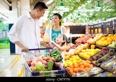 Family shopping in supermarket - Stock Photo
