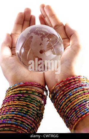 Hand holding glass globe on white background - Stock Photo