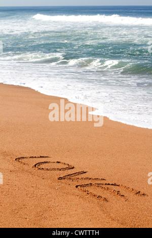 love written on beach - Stock Photo