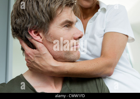 Close up of doctor examining patient - Stock Photo