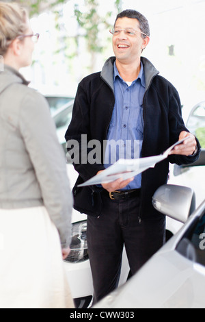 Business people talking by car - Stock Photo