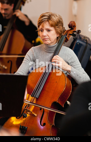 Cello player practicing with group - Stock Photo