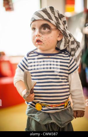 Boy wearing pirate costume - Stock Photo