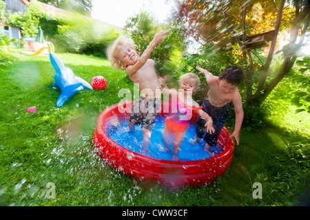 Three girls playing and splashing in garden paddling pool for Garden paddling pools