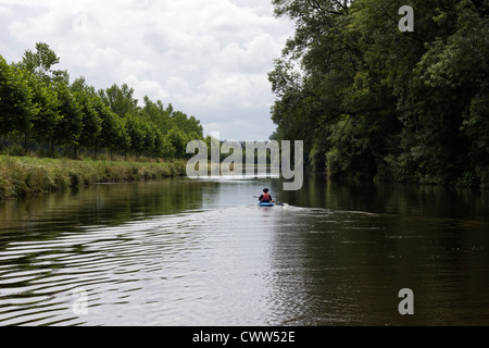 Canoeist on the Nantes Brest canal - Stock Photo