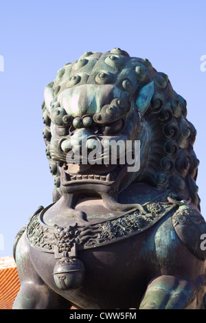 Statue of bronze Chinese lion - guardian of the Forbidden city, Beijing China