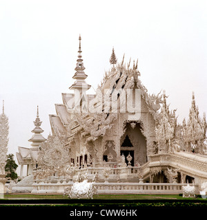 Wat Rong Khun White Temple Chiang Rai in Thailand in Southeast Asia Far East. Travel Religion Architecture Building - Stock Photo