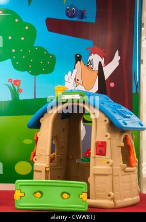 Toy house and slide in kindergarten, preschool - Stock Photo