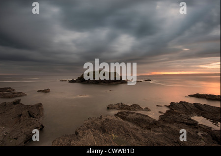 Blurred view of water washing on rocks - Stock Photo