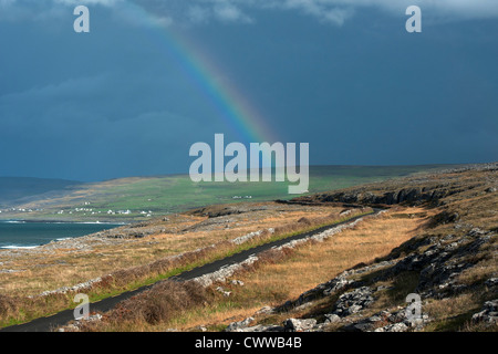 Rainbow over rural landscape - Stock Photo