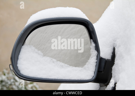 Snowy rear mirror with snow reflection - Stock Photo