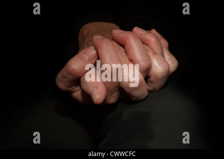 Mother and daughter holding their hands - Stock Photo