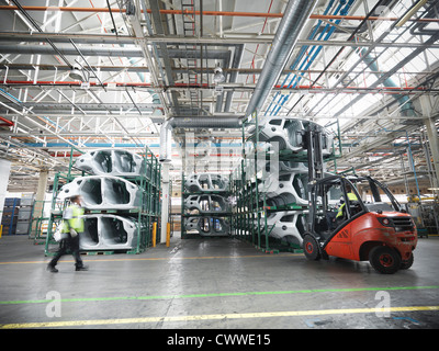 Car parts in car factory - Stock Photo