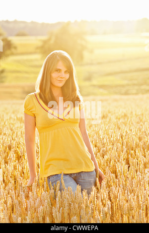 Smiling girl walking in tall grass - Stock Photo
